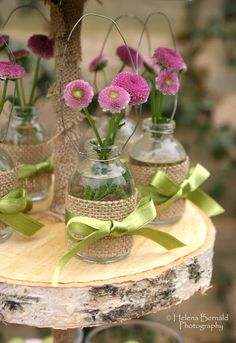 Cindy .How pretty! Flower in jars wrapped with burlap & ribbon ...