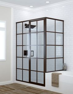 Grallcrafters' Metropolis Series framed shower doors, influenced by Tudor window architecture, fabricated with grid pattern, luxurious black metal finishes Frameless Shower Enclosures, Glass Shower Enclosures, Frameless Shower Doors, Shower Sliding Glass Door, Framed Shower Door, Custom Shower Doors, Bathroom Interior, Bathroom Ideas, Shower Tub