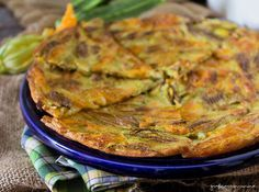 Schiacciata con fiori di zucca, una ricetta da non perdere, bastano un uovo, farina, sale, olio e tanti fiori di zucca per prepararla.