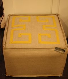 This ottoman from Ryan Studio in Interhall has gorgeous grosgrain detailing on natural linen.  A must see.
