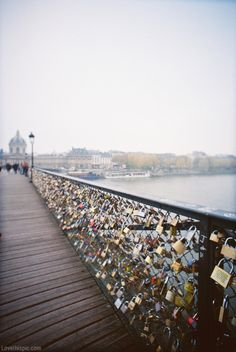 The love lock bridge in Paris♥  You hang locks on it with the name of you & your boyfriend/girlfriend/bestfriend then throw the key into the river. So even though the friend/relationship may end, you can't remove the lock. It stays there forever, as relevance to someone once a part of your life. -- Totally just added this to my bucket list!