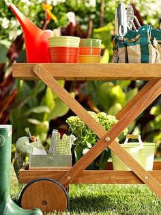 Use a patio serving cart as an all-in-one gardening center! More ways to organize garden gear: http://www.bhg.com/home-improvement/porch/outdoor-rooms/organize-garden-tools/?socsrc=bhgpin062313sevingcart=1