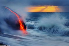Photographers brave boiling waters to capture images of lava crashing into the sea off Hawaii.