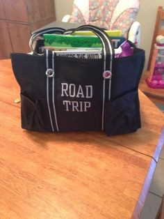 Entertainment for the kids in the car. Can place between them with activities, drinks and snacks! Organizing Utility Tote