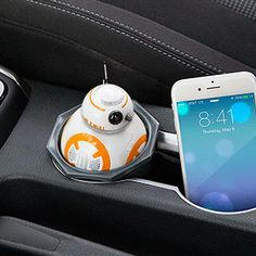 The Star Wars BB-8 USB Car Charger sits in your vehicle's cupholder, connected to the 12V vehicle power adapter (cigarette lighter). The head rotates and makes sound, but more importantly, it comes with 2 2.1A USB charging ports.