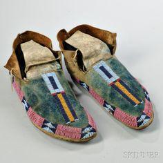 Pair of Cheyenne Beaded Buffalo Hide Moccasins | Sale Number 2862B, Lot Number 80 | Skinner Auctioneers