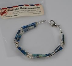 blue handmade recycled postage stamp beaded bracelet