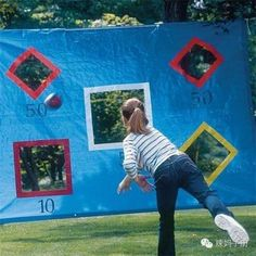 DIY Throwing Tarp. This game is super easy yet funny for your kids to get active in summer. Take a tarp, cut some squares, tape the cuts and hang with ropes and play ball with marker to designate points.