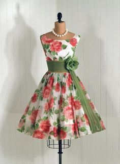 1950's Vintage Dress #fashion #dress #vintage by imogene -Coral pink flowers with green sash and flower; white backdrop and curved neckline