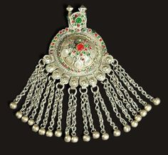 Pendant Baloch. Domed circular medallion, silver, decorated with