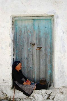 Blue door almost no collor left and a old lady - beautiful photo