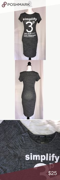 """NWT Gray Black Heather Jersey Knit Stretch Dress New with tags.  Gray & black heathered polyester knit dress.  White screen printed design.  Rounded neckline.  Tag says Medium but seems to run small to me. Check measurements before buying. It is very stretchy.  Pit to pit laying flat 16.5"""", waist 13"""", length 37.25"""". OMONSiM Dresses Midi"""