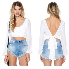 Longsleeve Tie-Back Crop Top (Wrapped Up In It) Never worn. Still has tag. Super cute crop top to pair with a high waisted skirt or shorts. Ties in a bow in back. no trades & no paypal Nasty Gal Tops Crop Tops