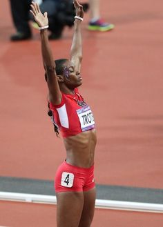 Dee Dee Trotter  Sanya Richards-Ross of the USA seen winning the gold medal in the 400m final at the Olympic Stadium, London Olympic Games 2012. She beat British runner Christine Ohuruogu who took silver while her team mate Deedee Trotter won the bronze.