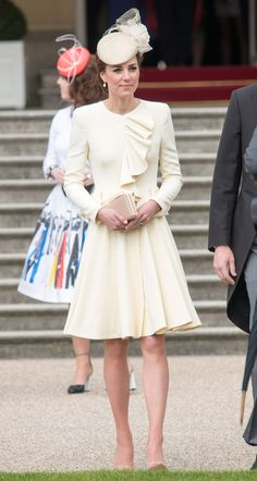 24 May 2016 - The Duchess of Cambridge attended a garden party at Buckingham Palace in a cream ruffled Alexander McQueen ensemble that she first wore to Prince George's christening.   - HarpersBAZAAR.co.uk