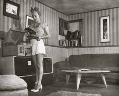 1940s woman in shorts at record player living room turban shirt top shoes pumps heels white found photo