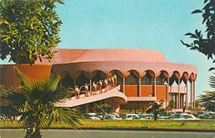 """Postcard c 1964 - """"The last design of Wright produced a fine arts center which commands notice from the world. Completely circular in design, with two-level pedestrian bridges expanding two hundred feet from either side, this magnificent view illustrates the success of the designer's hope that the structure would seem to say 'Welcome to Arizona'."""""""