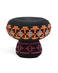 """CROSS CULTURAL    Inspired by Vietnamese basket weaving, the Swedish firm Glimpt has developed a line of yarn-wrapped seating for Cappellini that marries the Southeast Asian technique with Scandinavian-style patterns. The small stool, 18"""" dia. x 14"""" h., has a sturdy metal frame and costs $500. A large stool and an armchair are also offered. 212-620-7953; www.cappellini.it"""
