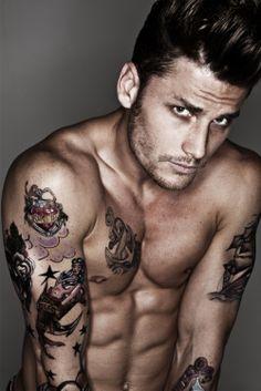 Hot Man tattooed and intense.