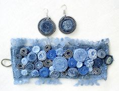 This is a unique denim wristband made from denim and lace . I love this!! The blue shades give this a ombré effect. I added vintage buttons,metal parts,,jeans beads Very classy and so southwest. This will fit a 6.5 wrist. 2 wide. This ecofriendly jewelry highlights vibrant personality. It makes a great gift for her. Gift box Returns Policy: to receive full refund (excluding postal cost), item must be returned within 14 days of receipt, unworn as new with tags. Customs charges may be…