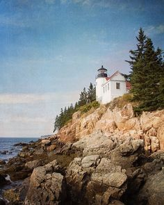 TITLE: Little Lighthouse on the Rocks LOCATION: Maine I love lighthouses - there is something charming and mysterious about these old structures that seem to both belong to land and sea. ABOUT MY ART