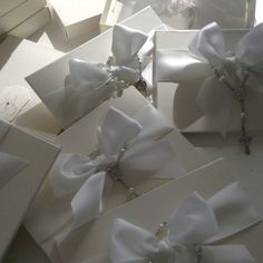 Boxed white pearl wedding invitation, jard cover book style with rosary
