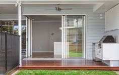 The Hamptons look gets an Australian update with the addition of a BBQ!   #hamptons #cladding #weatherboard #exterior #architecture #scyonwalls #hamptonslook #hamptonshome #Linea
