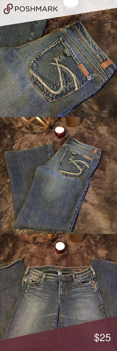Women's Silver Mirage jeans These super cute jeans are a size 31. They have a fun multi-colored pocket embroidery. They are perfect for any jean collection. Silver Jeans Jeans Boot Cut