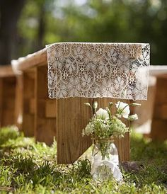 farm wedding ceremony outdoor rustic benches covered with lace