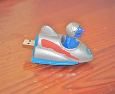 Flash drive from upcycled vintage Grover toy via Cool Mom Tech