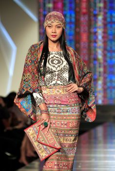 A model presents a creation by Indonesian designer Ghea S. Pangabean during the Jakarta Fashion and Food Festival, in Jakarta, Indonesia, on May 16, 2012. (EPA Photo/Bagus Indahono)