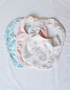 A personal favorite from my Etsy shop https://www.etsy.com/listing/223665921/aqua-pink-gray-floral-minky-3-piece-bib