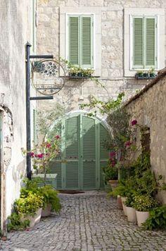 Beautiful green shutters, Alacati, Izmir, Turkey.