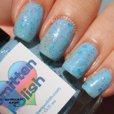 A swatch of Smitten Polish - Traveling By Bubbles! A pretty light blue creme base with blue round glitters and bigger teal round pieces with contrasting purple micro glitters!