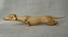Wooden figurine Dachshund is my original and unique hand carving work. Made of wood (cherry tree). Perfect as a gift or displaying it on your desk or shelf. Size of wooden sculpture Dachshund: length 33 cm (13 in.), height 6 cm (2,4 in.) Ready to ship in 1-3 business days. Wooden figurine Dachshund ships from Ukraine Usual shipping time of this hand carving work: 1 - 2 weeks Europe 2 - 4 weeks USA, Canada, Australia 2 - 4 weeks everywhere else You can find more different hand carving w...