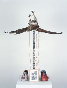 Paul Thek, Untitled (Buzzard), 1968, Wood, taxidermic buzzard, shoes, paint, metal, black-and-white photographs, string, Plexiglas, and wax, 130 x 107 x 50 cm, Museum Moderner Kunst, Stiftung Ludwig, Vienna, © The Estate of George Paul Thek; courtesy Alexander and Bonin, New York.