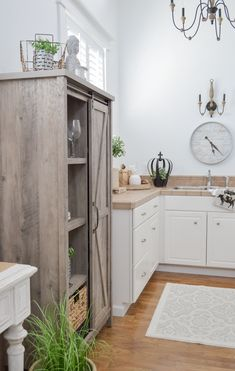 New Home Decorating Tips and Ideas | Open concept living room / kitchen. The Better Homes & Gardens barn door farmhouse cabinet makes a great stand in pantry in this small guest house kitchen. #Sponsored #farmhouse #kitchen #barndoor #pantry #bhgatwalmart