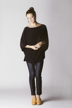 simply & classy! black baggy sweater/cardigan, black/dark blue jeans, tan/camel booties or wedges. Add a bright lip!
