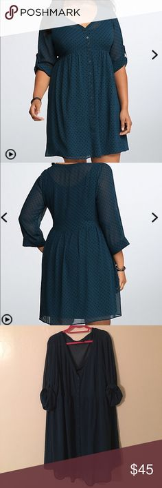Torrid Polka Dot Button Down Dress Dress is new without tags. In perfect condition. Figure flattering and comfortable to wear. Can dress up or down with ease. Color is a dark blue green with black polka dots torrid Dresses Midi