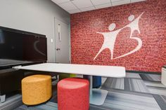 Big Brothers Big Sisters (Springfield, MO) Fringe lounge furniture and table with Whimsy impromptu seating in conference/collaborative space. #NationalOffice