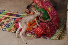 Bishnoi Woman is breast feeding to black Photo by Shivji Joshi -- National Geographic Your Shot