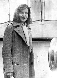 Legendary actress Greta Garbo is met by photographers as she arrives home to her native Sweden after a lengthy spell in the USA, (1935).
