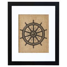 A delightful addition to a coastal-chic vignette, this charming framed burlap print showcases a nautical helm motif. Made in the USA.  ...