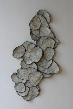 Merinowol, zijde gevilt Ruimtelijk gevilte panelen die onderling verschoven kunnen worden.