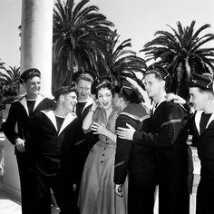 1955: Gina Lollobrigida is surrounded by French Navy sailors