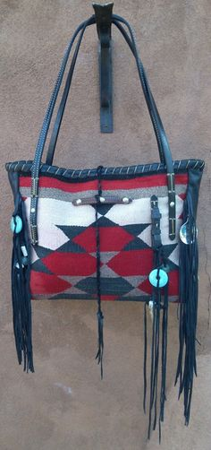 The BRISSA : Navajo Handbags made from blankets / rugs, vintage horse tack, and deer, elk or cowhide leathers. I embellish the bags with vintage trade beads, turquoise, coral, nickel silver/German silver Concho buttons, nickel silver spots/studs, and deer antler tips.