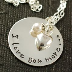 Sterling Silver Hand Stamped Necklace I Love You More by AnnieReh.      Sadie and I say this to each other.