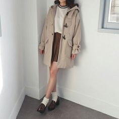 Korean fashion - striped collar top, brown pleated skirt, duffle coat and brown shoes