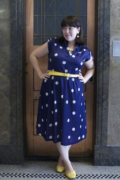 Navy and white polka-dot dress with yellow belt, shoes and earrings. Lilli at Frocks and Frou Frou