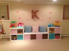Seating and storage with the IKEA Kallax shelves for playroom design!